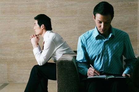 interviewed: Businessmen waiting to be interviewed