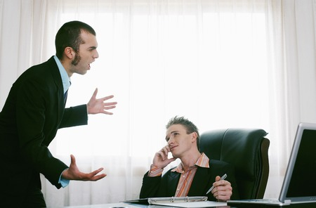 Businessman listening to his assistant talking photo