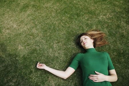 Woman lying on the field photo