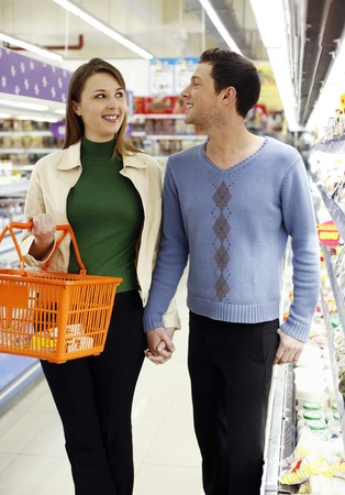 Couple shopping in the supermarket photo