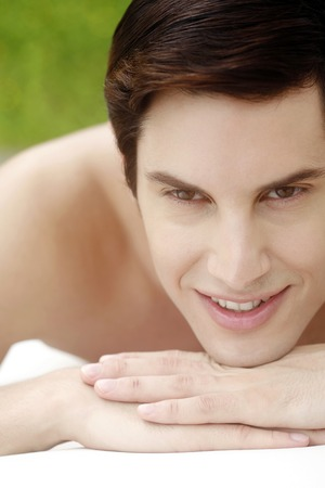 lying forward: Man lying forward on the massage table smiling