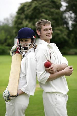 cricket bat: Man and woman holding a cricket bat and a cricket ball Stock Photo