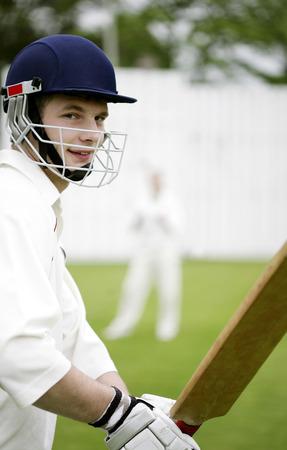 cricket bat: Man holding a cricket bat