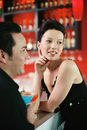 Man and woman standing at the bar counter photo