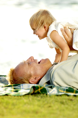 Man playing with his young daughter photo