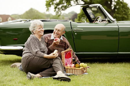 Senior couple picnicking in the park photo