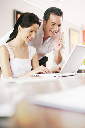 Couple using laptop photo
