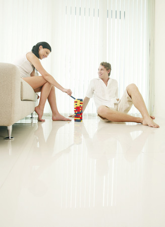two persons only: Couple playing plastic blocks at home