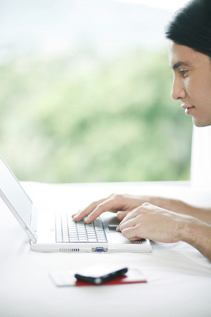 Man using laptop photo