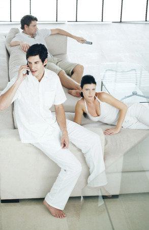 Men and woman lazing around at home photo