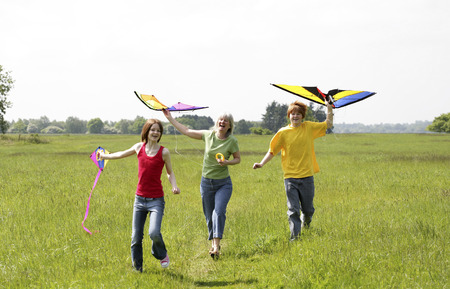 Woman and her children flying kites photo