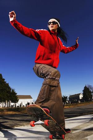 Woman on skateboard photo