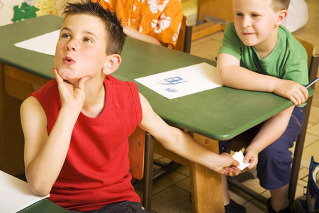 Boys passing note under the table