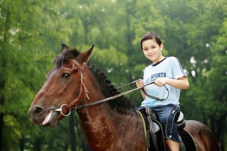 horseback riding: Boy riding a horse
