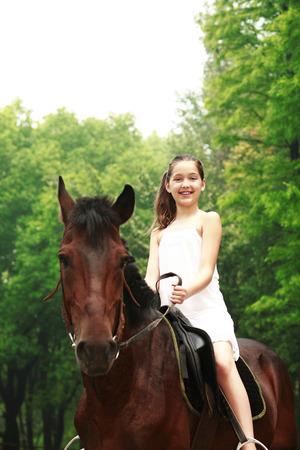 Girl riding a horse photo
