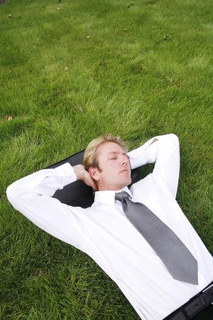 power nap: Businessman lying on the grass