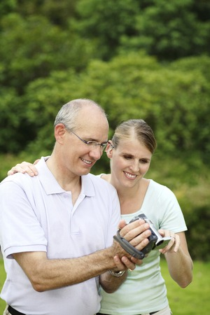Husband and wife viewing playback photo