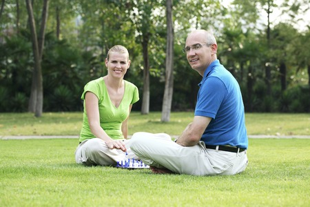 Husband and wife playing chess photo