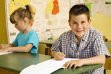 Children colouring in the classroom photo