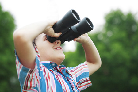 Boy with binoculars photo