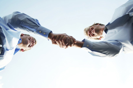 negotiation business: Business handshake Stock Photo