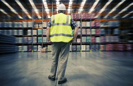 Man looking at warehouse goods photo