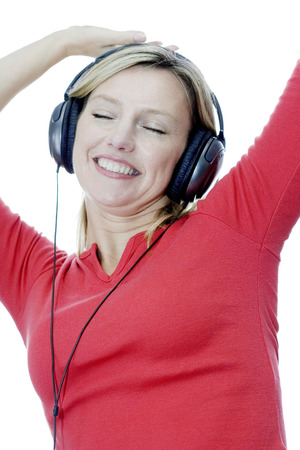 Woman listening to music on the headphones photo