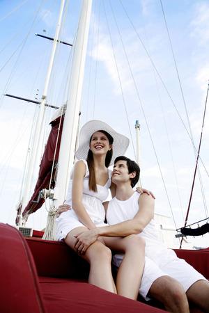 Couple sitting on yacht photo