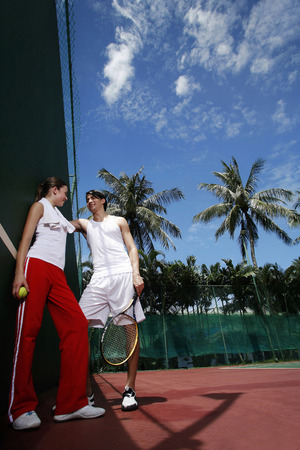 Couple talking in the tennis court photo