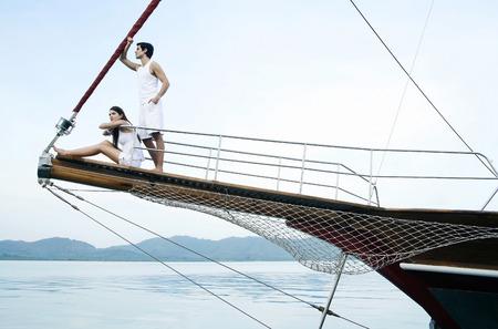 Couple sailing on yacht photo