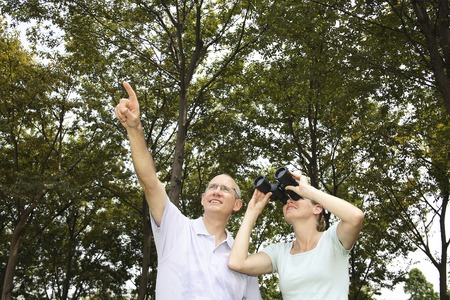 Husband and wife on bird watching excursion