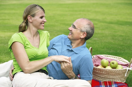 Husband and wife picnicking photo