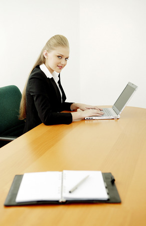 Businesswoman working on a laptop photo