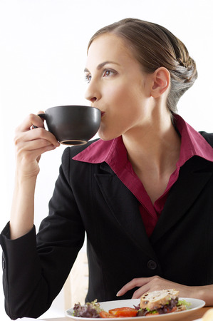 sipping: Businesswoman sipping coffee Stock Photo