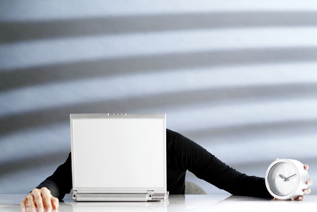 Businesswoman dozing off on a laptop