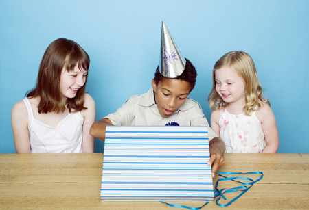 unwrapping: Boy unwrapping his present Stock Photo