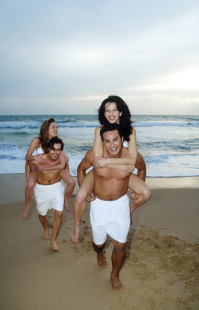 Men carrying their girlfriends on their back photo