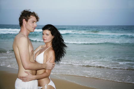 Loving couple on the beach photo