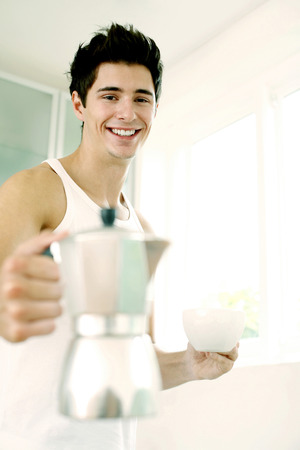 Man holding a jug and a cup photo