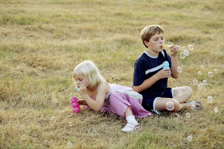 Children blowing bubbles photo