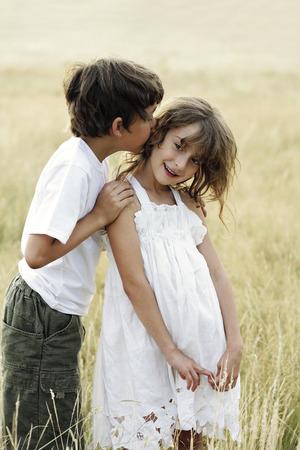 Boy kissing girl photo