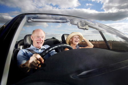 Senior couple traveling in the car photo