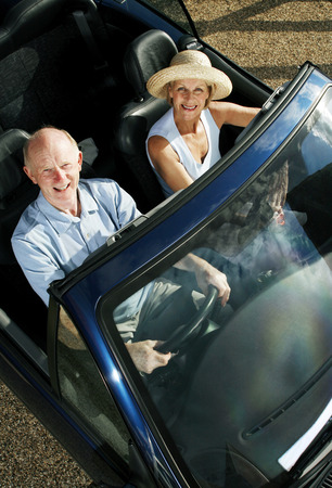 convertible car: Senior couple traveling in the car