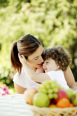Mother and daughter hugging photo