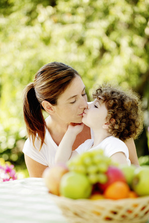 Daughter kissing mother photo