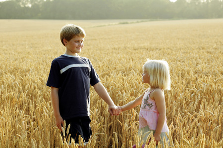 reassure: Brother holding sisters hand