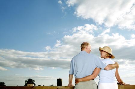 Senior couple enjoying the beautiful view together photo