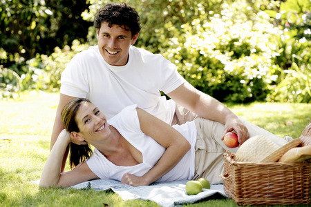 picnicking: Couple picnicking in the park