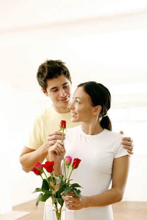 Couple with a vase of roses Stock Photo - 26204560