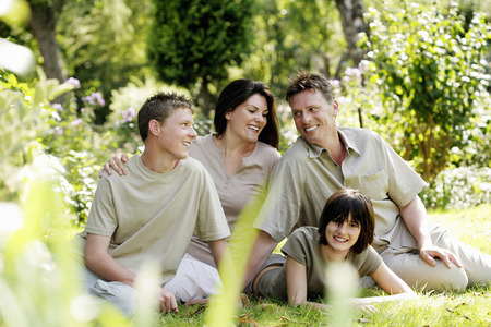 Parents and children posing in the park photo